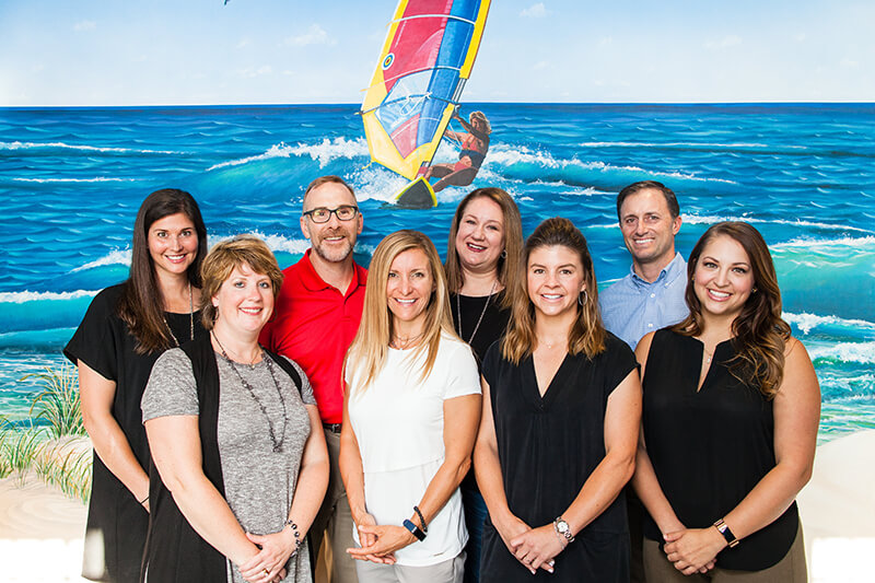 Team picture by the surf - Pediatric Dentistry and Orthodontics in Corpus Christi, TX